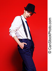 trousers with suspenders - Fashion shot. Attractive young...