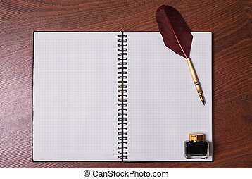 a sheet of paper from a notebook, fountain pen and ink on wooden background, copyspace