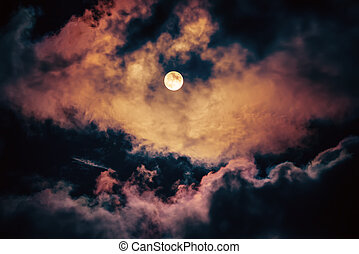 The moon on the dark sky among the clouds, natural abstract...