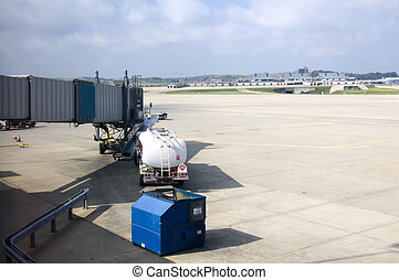 Tanker waiting - Jet fuel tanker waiting to fuel a...