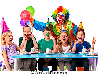 Birthday child clown playing with children. Kid holiday cakes celebratory.