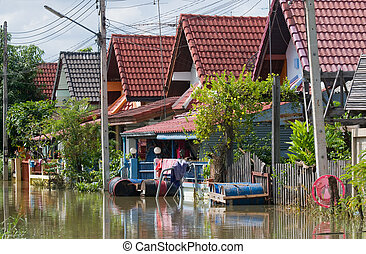 Flooded village road in Thailand - Flooded village road in...