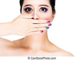 colorful and make up concept with young lady with hand on...