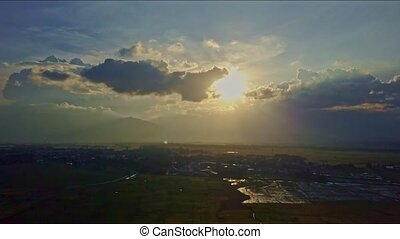 Aerial View Skyline with Evening Sun behind Light Clouds -...