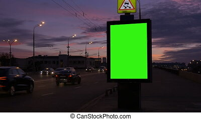Tame lapse A Billboard with a Green Screen on a Busy Street.