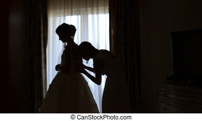 A Bride Getting Dressed for the Wedding