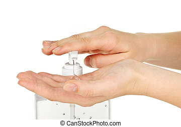 Hands with sanitizer gel - Female hands using hand sanitizer...