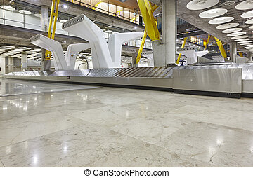 International airport baggage belt claim area. Nobody. Travel background.
