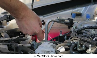Checking Engine Oil - Checking the engine oil level of a car