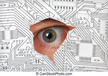 Eye looking through a hole in electronic circuit - Human eye...