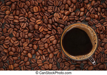 Cup of coffee on beans