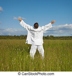 Man enjoys nature and fresh air in a field