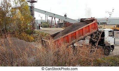 Truck unloads rubble - At the enterprise, the truck raises...
