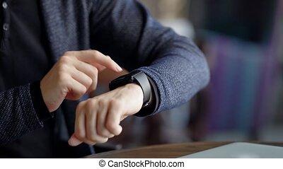 Crop shot of man checking time. Crop shot of male using...