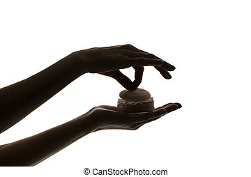 silhouette of female hands holding face powder isolated on...