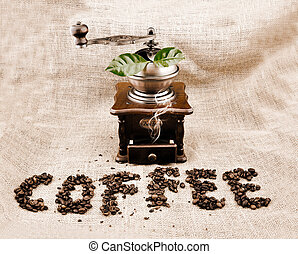 vintage coffee grinder and sign coffe from coffee granules...