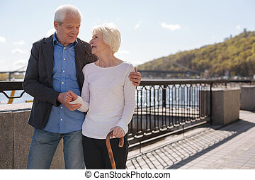 Charmed couple enjoying pastime together near the river -...