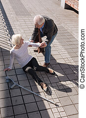 Easy going woman having painful accident on the street - We...