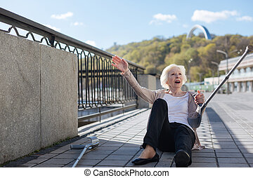 Disturbed woman lying on slabs on the quay