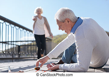 Frightened pensioner dropping pills on the payment
