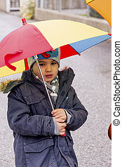 child with umbrella, a symbol of childhood, solidarity,...