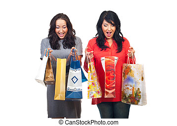 Two amazed women about their shoppings