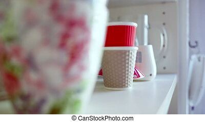 Focusing in on a Mug - A shot slowly comes focuses in on a...