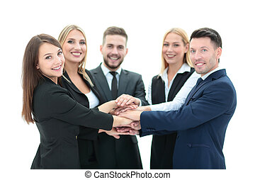Happy business team showing unity with their hands together...