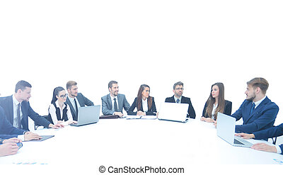 business partners with documents and laptops sitting around the
