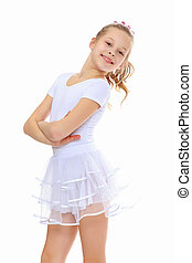 Girl gymnast in a white tracksuit. - Beautiful little girl...