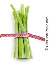 green celery sticks on white background - photo shot of...