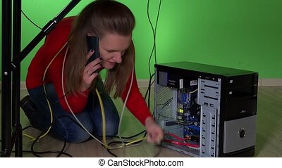 business woman having computer problem and calling for help with mobile phone