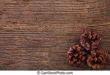 Pinecones on wooden background