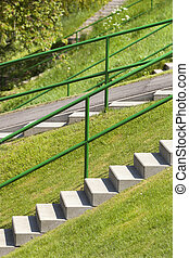 Concrete staircases on a grass dike in the Netherlands