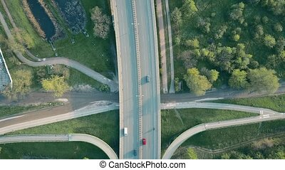 Aerial shot of a highway in the evening, top down view. 4K...