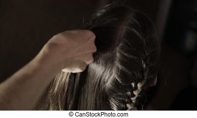 girlfriend plaiting pigtail for young brunette woman -...