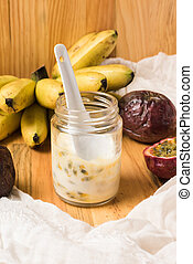 Glass jar with yogurt on wooden background. - Breakfast with...
