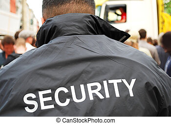 security man - security guard in front of crowd