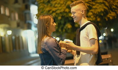 Young couple talking holding hands