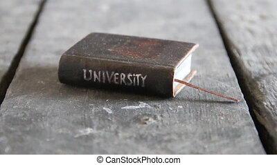 university course idea - Vintage book with inscription...