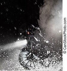 High power motorcycle chopper with man rider at night -...