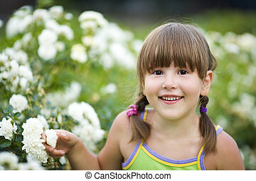Girl smiling outdoors