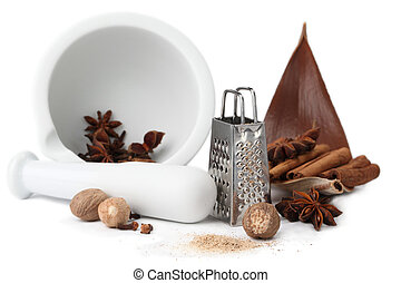 Spices, grater and mortar - Close-up of nutmegs, cloves,...