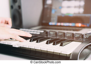 Keyboard player is recording song in home studio