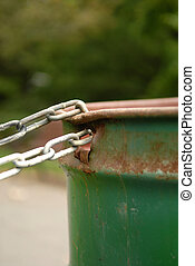 Chained Garbage Can - Portrait - Image of a chained rusted...