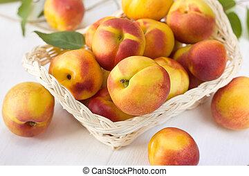 Nectarine - Fresh nectarine in  basket on wooden board