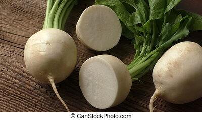 Tasty fresh crude white round japanese radish with green...