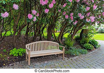 Garden Wood Bench Under the Rhododenron Shrubs - Garden Wood...