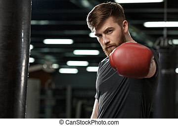Serious handsome young strong sports man boxer