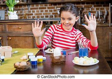 Girl painting easter eggs